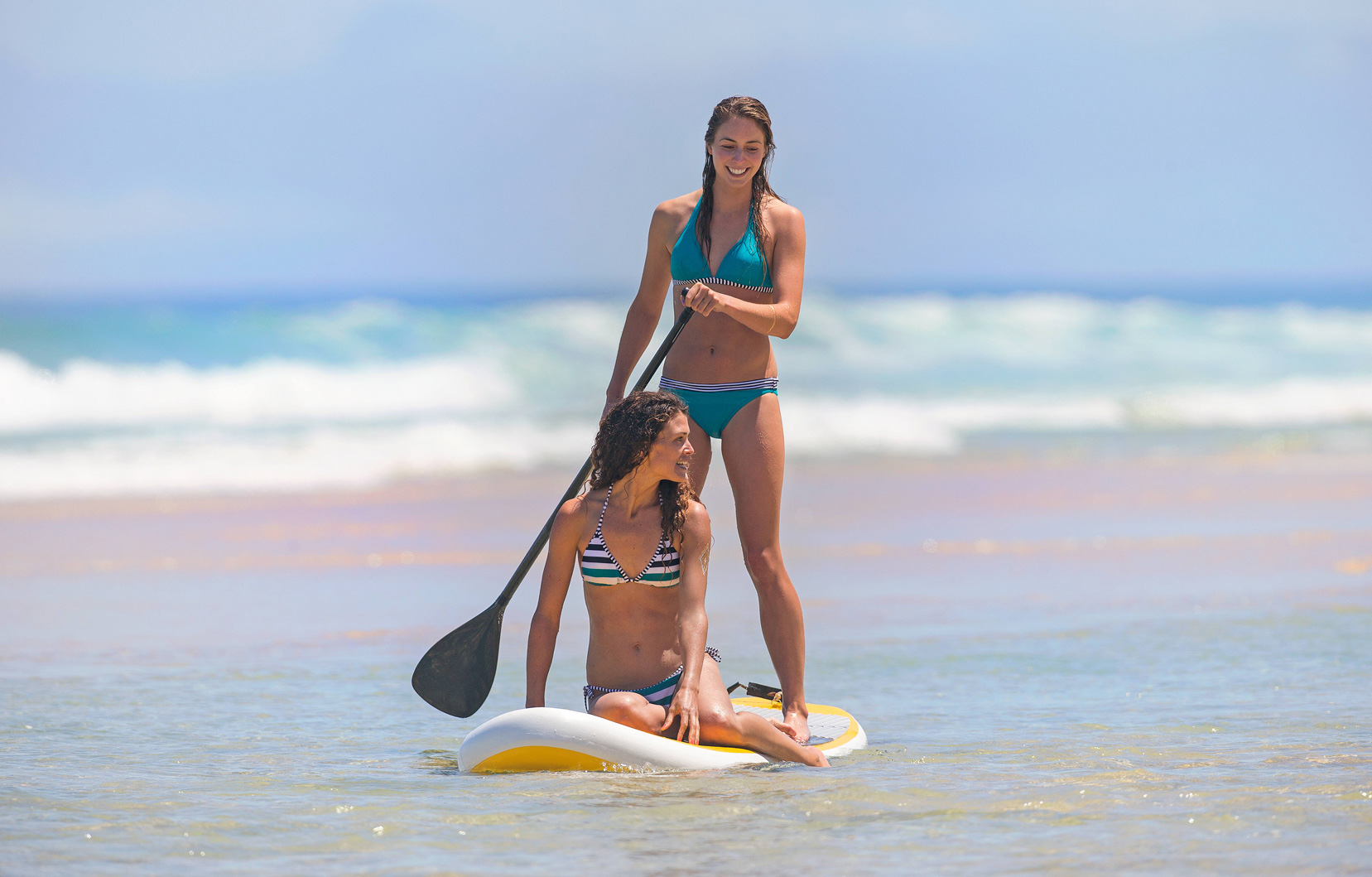 tablas de surf stand of paddle